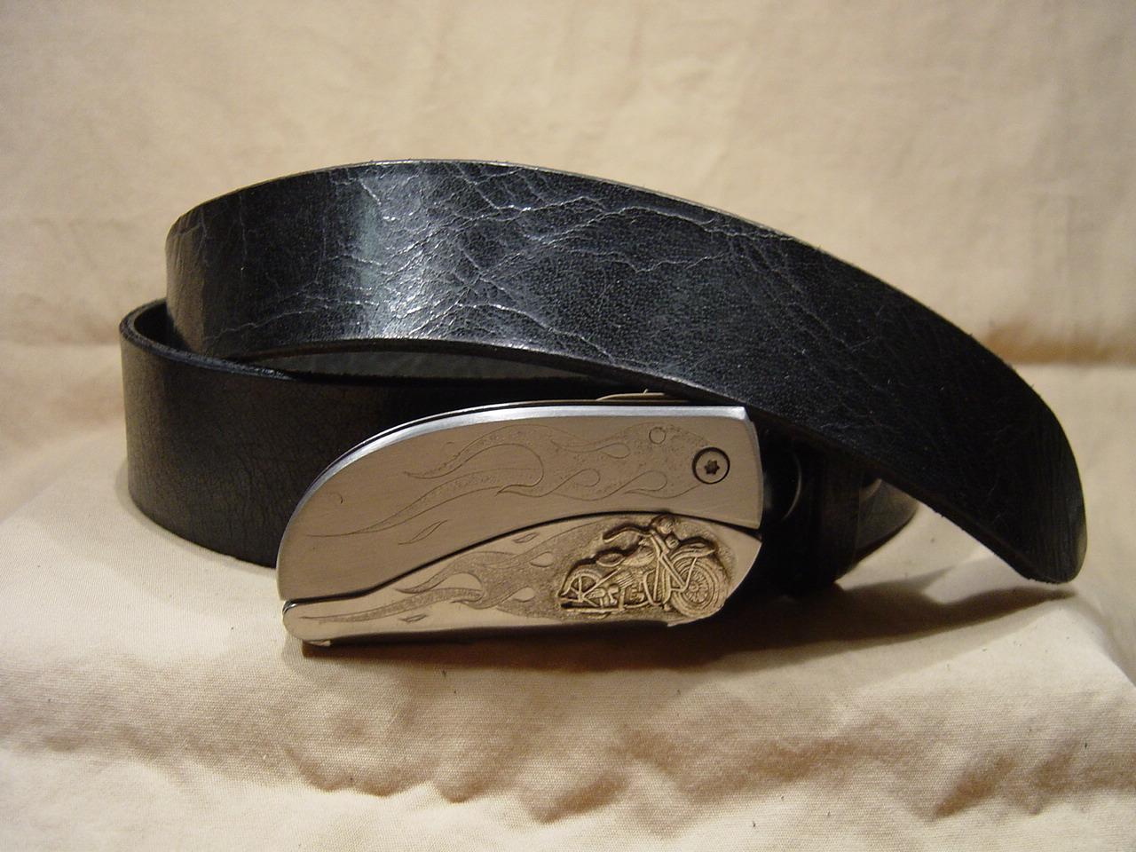 Antique black leather belt with belt buckle knife