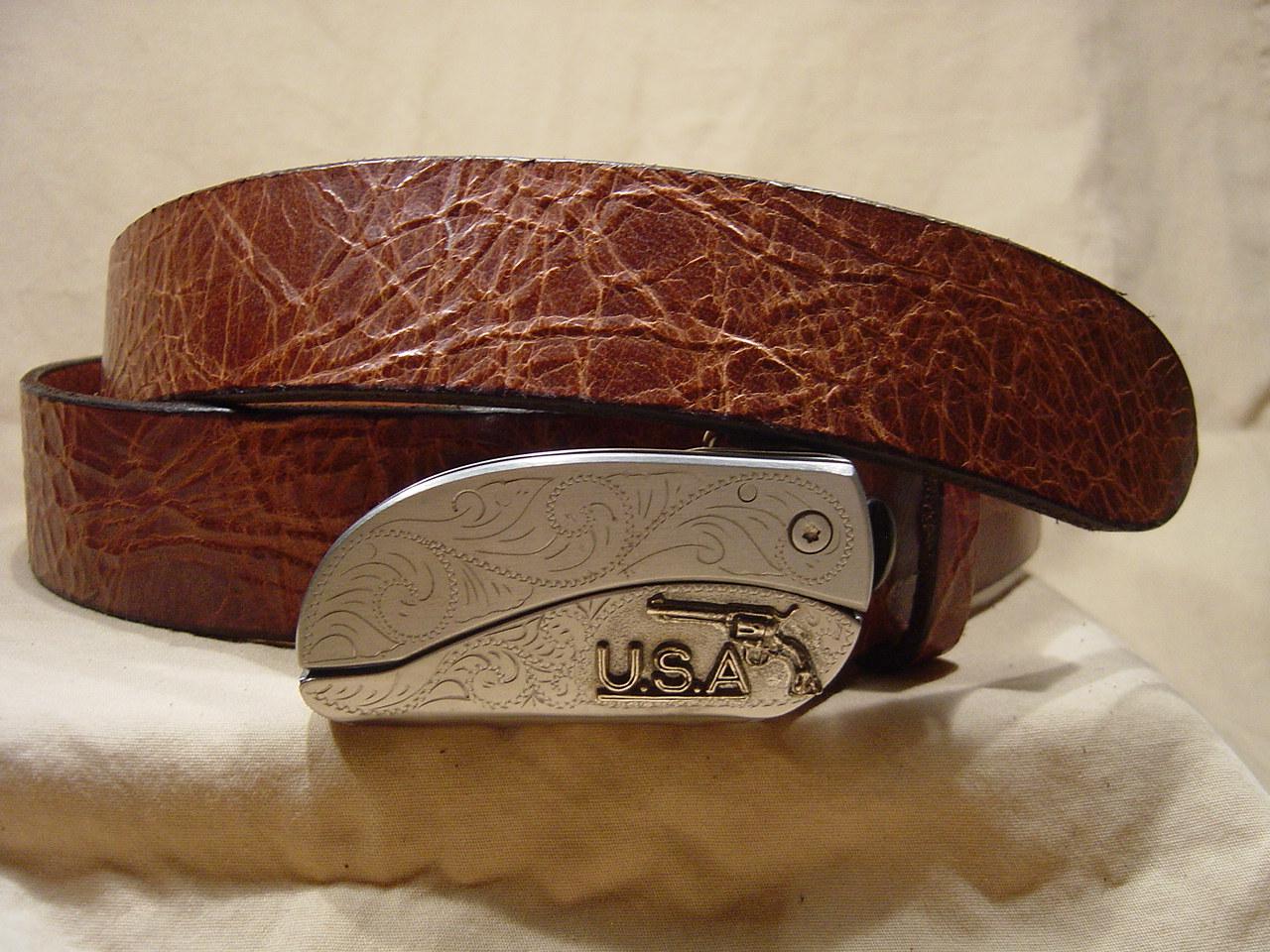 Antique tan leather belt with belt buckle knife